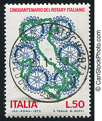 Map of Italy and rotary emblem
