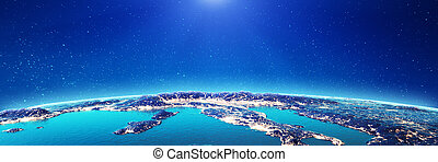 Italy city lights. Elements of this image furnished by NASA...