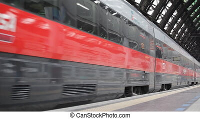 ITALY, MILAN-MAY 7,2014: The modern high-speed train at the station. The central railway station of Milan (ital. Milano Centrale) is one of the largest stations of Europe.