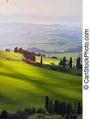 Italy; San Quirico d'Orcia; sunset over Tuscan Valdorcia ...
