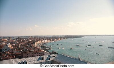 Italy, Venice. City overview from the high point. Sea, boats...