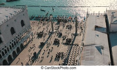 Italy, Venice. People walking on the quay. View from the...