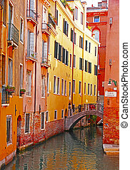 Italy. Venice. Romantic canal with bridge among old colorful brick houses