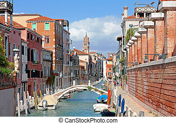 Italy. Venice. Romantic canal with bridge among old colorful houses