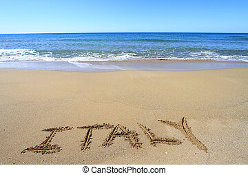 Italy written on sandy beach