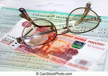 items for auto insurance - Russian money, glasses and papers...