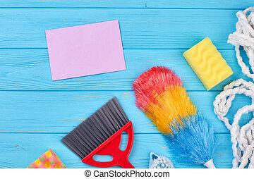 Items for cleaning on wooden background.