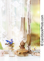 Iterior window with vintage lamp and wildflowers