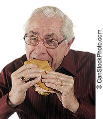 Its a Great Ham Sub - A senior man enjoying a great...