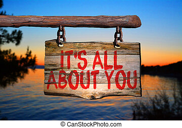 It's all about you motivational phrase sign on old wood with...