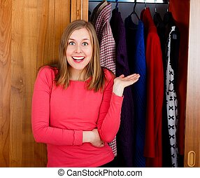 It's my New Closet! - Excited young woman in front of her ...