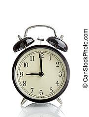 it's nine o'clock already, time to wake up for breakfast, vintage old black metallic alarm clock