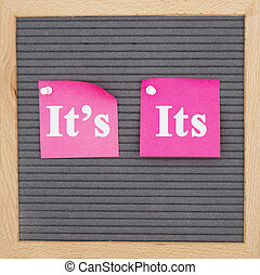 It's or it on two sticky note on gray felt letter board with...