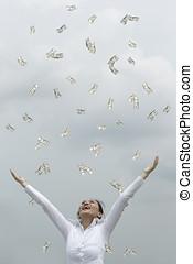 Its raining money - Conceptual Stock image of a man & woman...