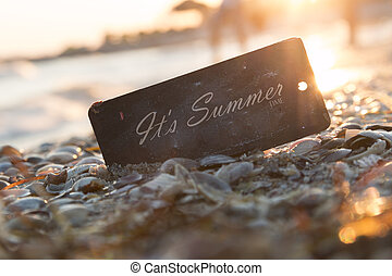 It's Summer time text and sunset on the beach.