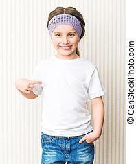 little girl in a white t-shirt