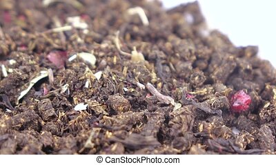 Ivan-tea with a dog rose - A pile of fermented tea with...