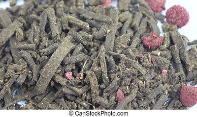 Ivan-tea with raspberries - A pile of fermented tea with...
