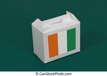 Ivory Coast flag on white box on green background. The concept of export trading from Ivory Coast