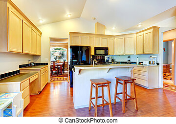 Ivory kitchen cabinets with black appliances - Light tones...