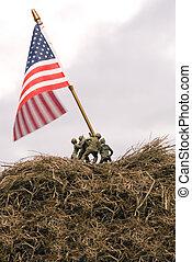 A re-enactment of the Iwo Jima flar raising.