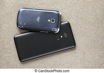 jämförelse, gammal, telefoner, mobiltelefon, mobil, lätt, concept., nymodig, utrymme, två, tyg, svart, bakgrund., framsteg, färsk, avskrift, teknologi, ersättning