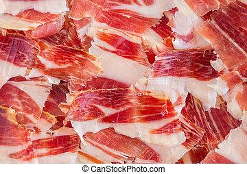 jabugo ham plate closeup - Top view of jabugo ham slices,...