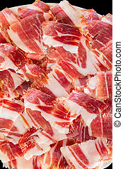 jabugo ham plate closeup - Top view of jabugo ham slices,...