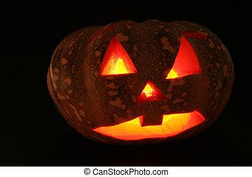 A dark glowing jack o lantern for halloween