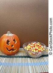Jack-O-Lantern and bowl of candy corn