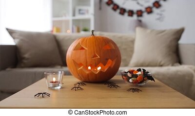 jack-o-lantern and halloween decorations at home - holidays...