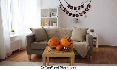 jack-o-lantern and halloween decorations at home - holidays,...