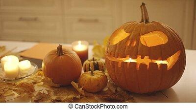 Jack-o-lantern and pumpkins - Creepy jack-o-lantern with...