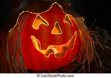 Fiber Optics lighted carved Halloween pumpkin with a jagged happy smile.