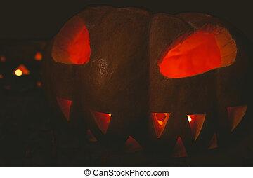 Jack o lantern glowing in darkroom during Halloween - Close ...