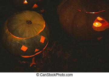 Jack o lantern glowing in darkroom during Halloween - High ...