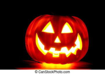 Jack-o-Lantern - Glowing jack-o-latern isolated over a black...