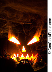 Jack-o-lantern in smoke - Jack-o-lantern with blazing and...