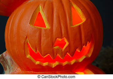 Lighted carved Halloween pumpkin with a jagged happy smile.