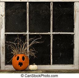 Jack-O-Lantern On A Window Ledge