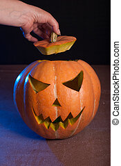 Jack-o ' - lantern on a wooden table,