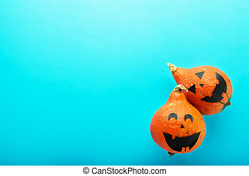 jack-o'-lantern on blue background. Happy Halloween party invitation, celebration. Halloween decorations concept. Flat lay, top view, copy space.