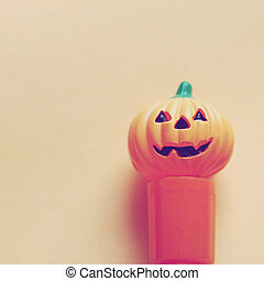 Jack o lantern pumpkin on paper with retro filter effect