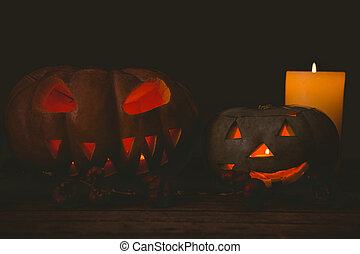 Jack o lantern with candles in darkroom during Halloween - ...