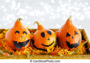 jack-o'-lantern with sweet candy , worms, spiders on white background with lights. Happy Halloween party invitation, celebration. Halloween decorations concept. Copy space.
