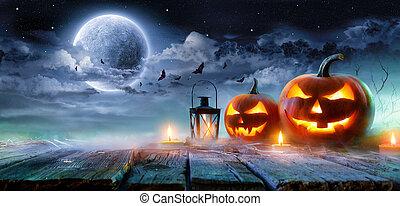 Jack O' Lanterns Glowing At Moonlight In The Spooky Night - Halloween Scene