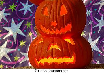 Halloween decoration - pumpkins carved into lighted jack-o-lanterns.