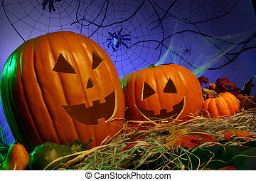 Halloween Theme: Jack-o-Lanterns in hay with spider webs in the background