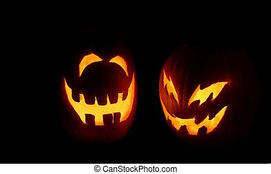 Jack-o-Lanterns - Two carved pumpkins glow on Halloween...