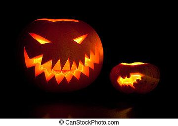 Jack-o'-lanterns, spooky Halloween pumpkins glowing in the...
